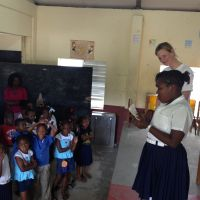 Grenada 2013. Following a book delivery to Samaritan Union School, Sonya White listens to a local poet. image