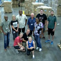 July 2016, volunteers stacked over 10,000 lbs. of books for Vieux Fort schools. St. Lucia Consul General, Michael Willius (Back row, left) helped, too. image