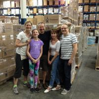 June 2015, volunteers at our Bolton warehouse prepare 14 skids of books for schools. image