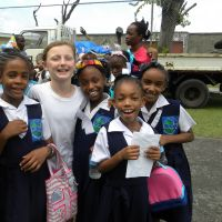 Student Ambassador Marlaina White (centre). 2015 was Marlaina's third time seeing girls from Reunion Primary. image