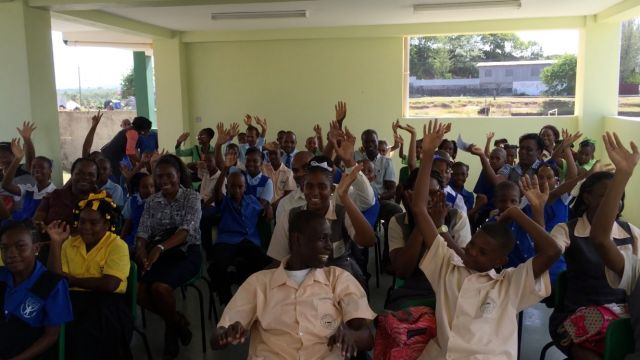 The hand-over ceremony was attended by students from nine schools in the Micoud district. image