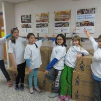 William Dunbar School students point out the benefit of book drives: to engage both donors and recipients in literacy. image